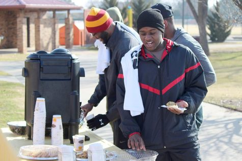 Preston Busby, criminal justice freshman, Keith Ngondo, nursing freshman, and Josh Cartright get some hot chocolate and cookies after runinng the 1 mile Cookie Dash set by the University Programming Board at Sikes Lake, Jan, 23, 2016. Photo by francisco Martinez