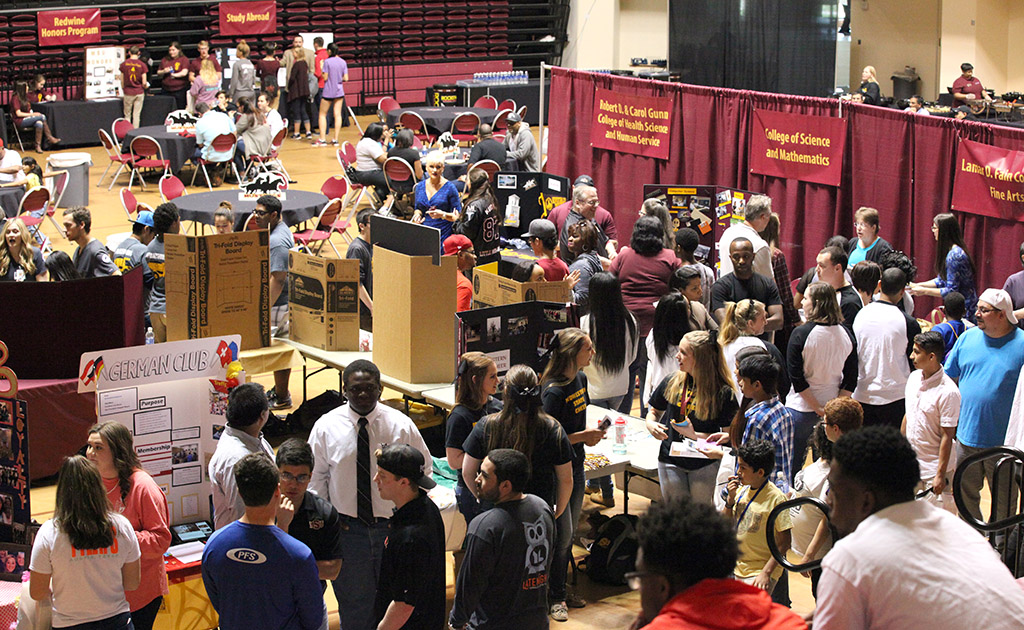 Prospective Students and their families and guests go around to visit different student organization booths and get the food provided by Chartwells at Mustangs Rally held in the D.L. Ligon Coliseum on March 4. Photo by Makayla Burnham