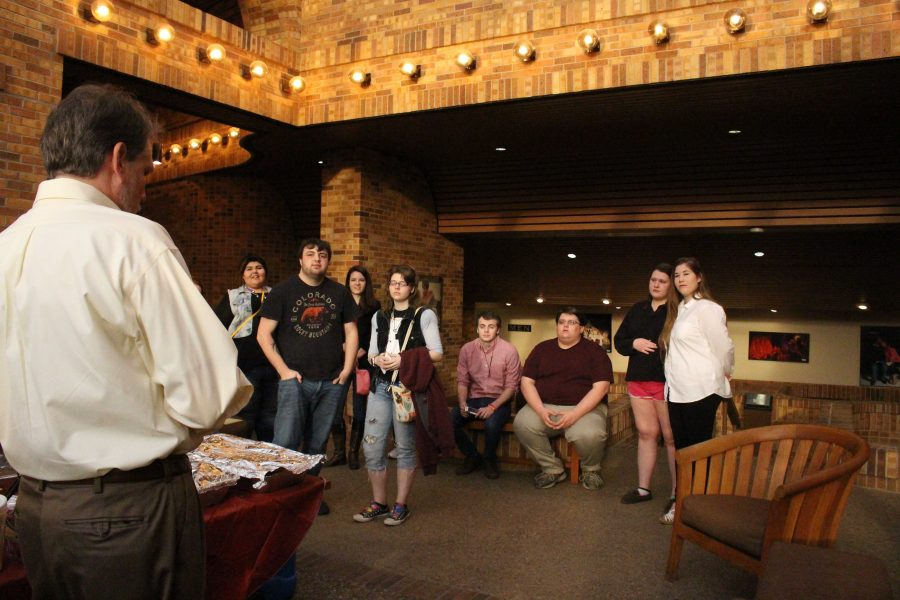 Actors and Student listen to Dr. Todd Giles, head of the Arts and Literature Society, at the beginning of the Lysistrata play meet-and-greet on March 5th in the Fain lobby. Photo by Kayla White.