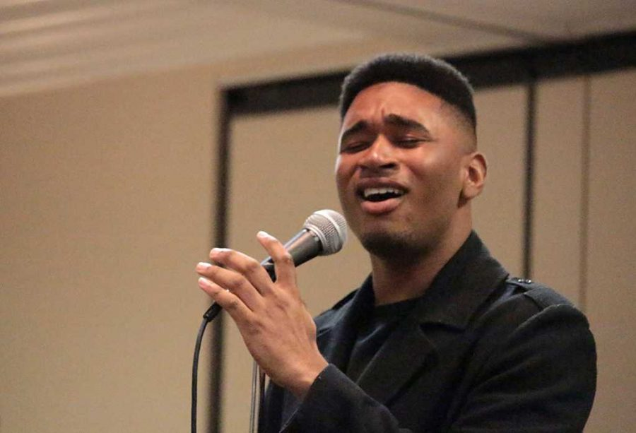 Lowell Nash, mass communication junior, sings at the Black History Month Talent show in Comanche Suites hosted by the Black Student Union and the Universal Programming Board on Feb 18. Photos by Kayla White.