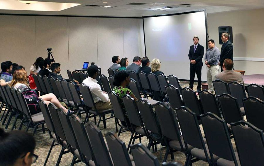 Wyatt McDevitt busiess management senior, Kaleb Hernadez, English senior, and Michael Dickey business management junior, present their IDEA Wichita Falls project. April 28. Photo by Topher G. McGehee