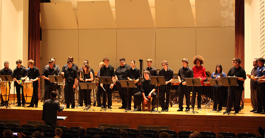 Local high school percussion members and the MSU percussion ensemble lead by Gordon Hicken, associate band director, perform in Akin Auditorium on April 18 with a crowd of about 120 people. Photo by Makayla Burnham