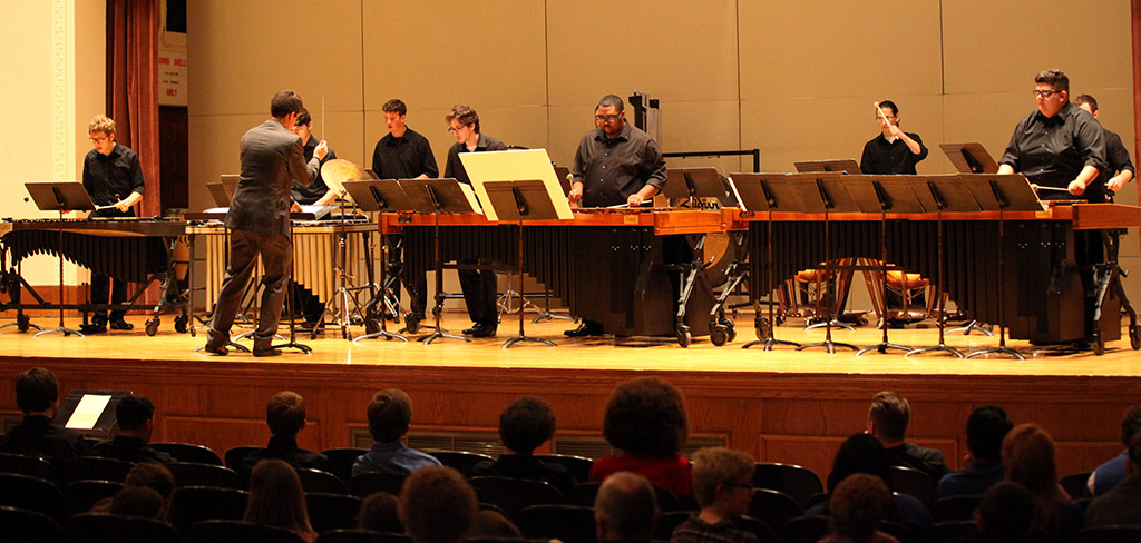 Members of the MSU percussion ensemble lead by Gordon Hicken, associate band director, perform in Akin Auditorium on April 18 with a crowd of about 120 people. Photo by Makayla Burnham