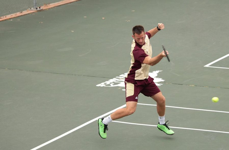 Kyle Davidson, accounting and finance senior, hitting a tennis ball just served at the MSU mens tennis vs. Colorado Mesa tennis match on March 13th at the MSU tennis courts, later winning 8-1 overall. Photo by Kayla White.