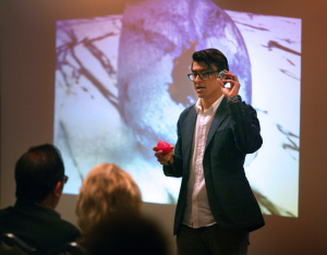 Michael Olaya discusses a three-dimensional printer than can print body parts at the Undergraduate Research and Creative Activities Forum, April 28, 2016. Photo by Bradley Wilson