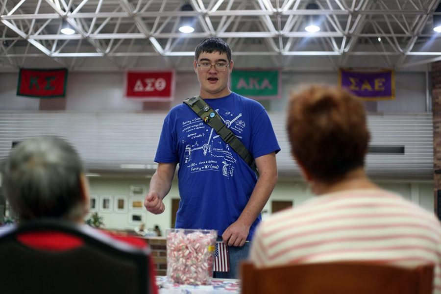 Braeden Alves mechanical engineering freshman discusses voter registration with the League of Woman Voters representatives. I love America because the freedom to vote and of course free mints! Spetember 16, Photo by Topher McGehee