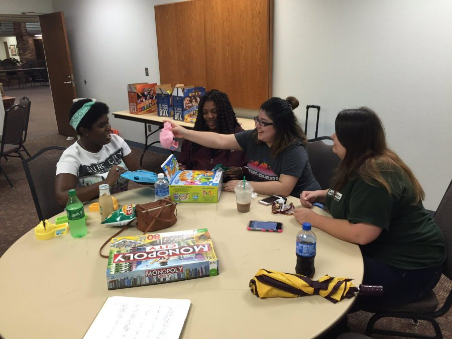 Julia Lucas, early childhood education sophomore, Kierian Hunter, math sophomore, Veronica Chuca, radiology sophomore, and Alyss Mitchell, mass communication sophomore enjoy Hungry Hungry Hippo at Game Night.