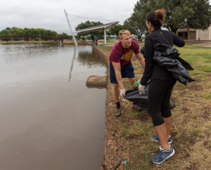Brooks Rock (nursing senior) and Kassandra Alonso (nursing senior) at the Sikes lake clean up. Photo by Izziel Latour