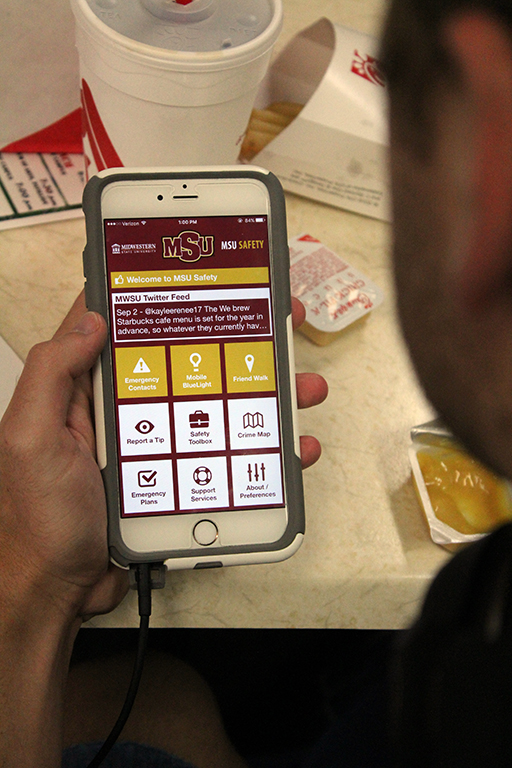 Houston Pokorny, theater senior checks out the new MSU Safety app on his phone. Photo by Jeanette Perry.