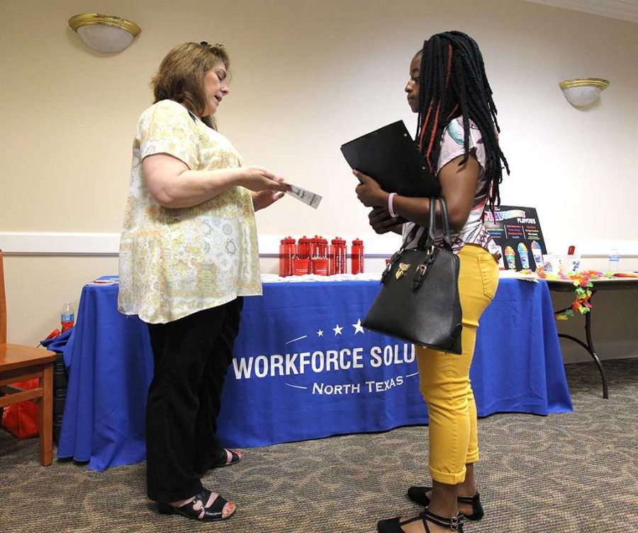 ShaDera Williams, athletic training freshman, talks to a Workforce Solutions representative at the Part-Time Networking Job Fair on Sept. 7, 2016. Photo by Izziel Latour.