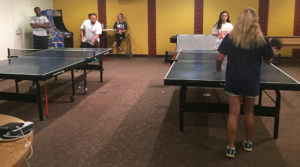 Back right: Nicole Leung, marketing senior, plays in the table tennis tournament on Sept. 8. Photo by Sam Sutton