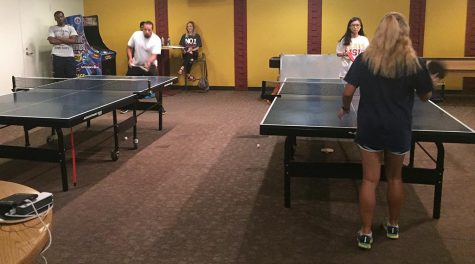12 students compete in table tennis tournament
