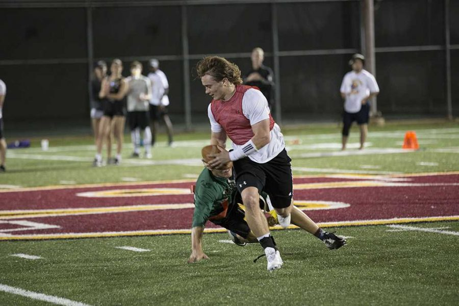 Hayden Lewis, nursing junior, playing flag football on Oct. 11. Photo by Izziel Latour