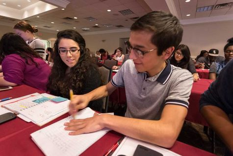 Christopher Cruz, theater performance sophomore, and Maria Isabel Pena, political science junior, talk with each other at the student government meeting Oct. 4. Photo by Izziel Latour