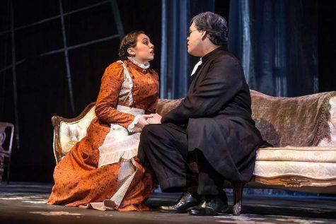"Evagelia Economo, theater freshman, and Ronny Medina, theater junior, rehearse for ""Ghosts"" Oct. 4. Photo by Izziel Latour"