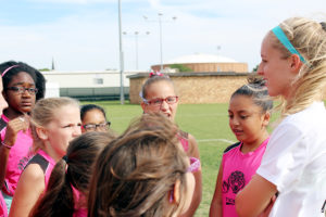 Madison Davis, criminal justice freshman, speaks with girls from the Pink Tigers soccer team.