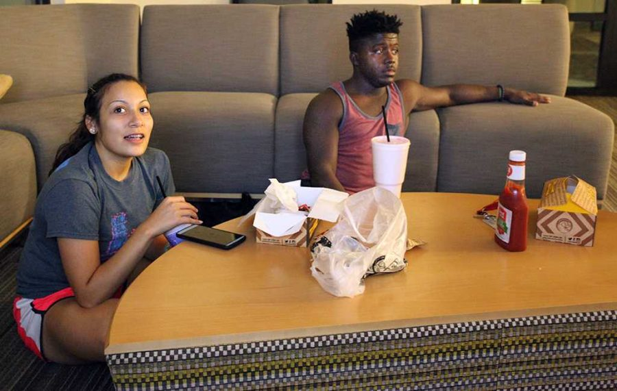 Marissa Rios, athletic training freshman, and DJ Ellison, business management, watch Dance Moms in lieu of the Vice Presidential Debate Oct. 4. Photo by Dewey Cooper.