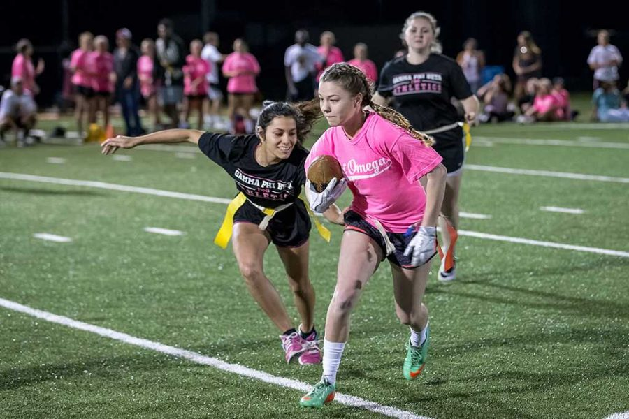 Delaine O'Connell, nursing freshman and member of Chi Omega, played flag football on Oct. 11. Chi Omega beat Gamma Phi Beta 32-20. Photo by Izziel Latour