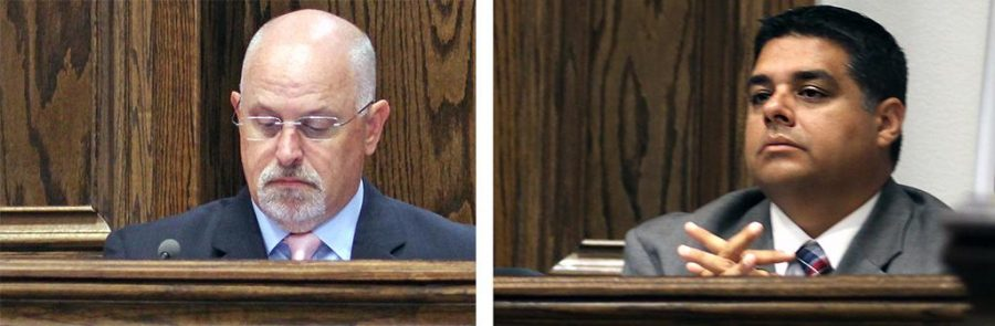 Tim Ingle and Stephen Santellana, city councilmen, attend a City Council meeting Oct. 4. Photo by Dewey Cooper