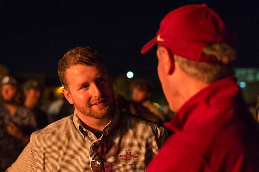 Jessie Brown, graduate student, talks to head football coach Bill Maskill at the Homecoming bonfire Oct. 27. Photo by Izziel Latour