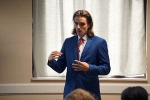 """Luca Lalor, finance and computer science senior, presents """"Methods of Generating alpha from FX Trading Using Technical Analysis: Evidence from Algorithmic Simulation."""" Photo by Topher McGehee."""