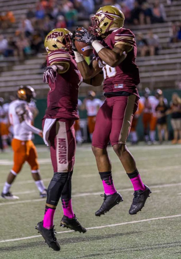 Jerryl Yarbourgh, acounting/finance junior, Quinton Childs, criminal justice sophmore, at the Homecoming football game against UTPB. Photo by Izziel Latour