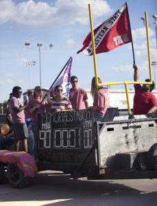 Members of Gamma Phi Beta and Tau Kappa Epsilon participate in the Homecoming float competition on Oct. 28. Photo by Makayla Burnham