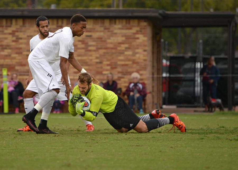 Leon Taylor tries to break a fall by Goalie Noah Fazekas at the Heartland Conference playoff game against St. Edward's. MSU lost 0-2. Photo by Zack Santagate
