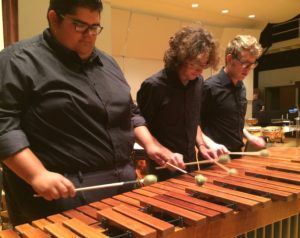 Ricardo Forester, Jacob Partida, and Lee Ginnings playing on marimba. Photo by Emily Simmons