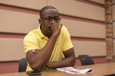 Charles Kabangu, nursing senior, watches the student debate on Nov 2. Photo by Izziel Latour