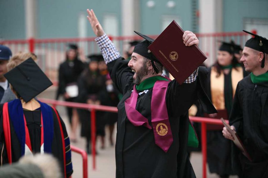 Radiologic sciences major Kyle Morford celebrates after the ceremony at Midwestern State University fall graduation Dec. 17, 2016. Photo by Brendan Wynne