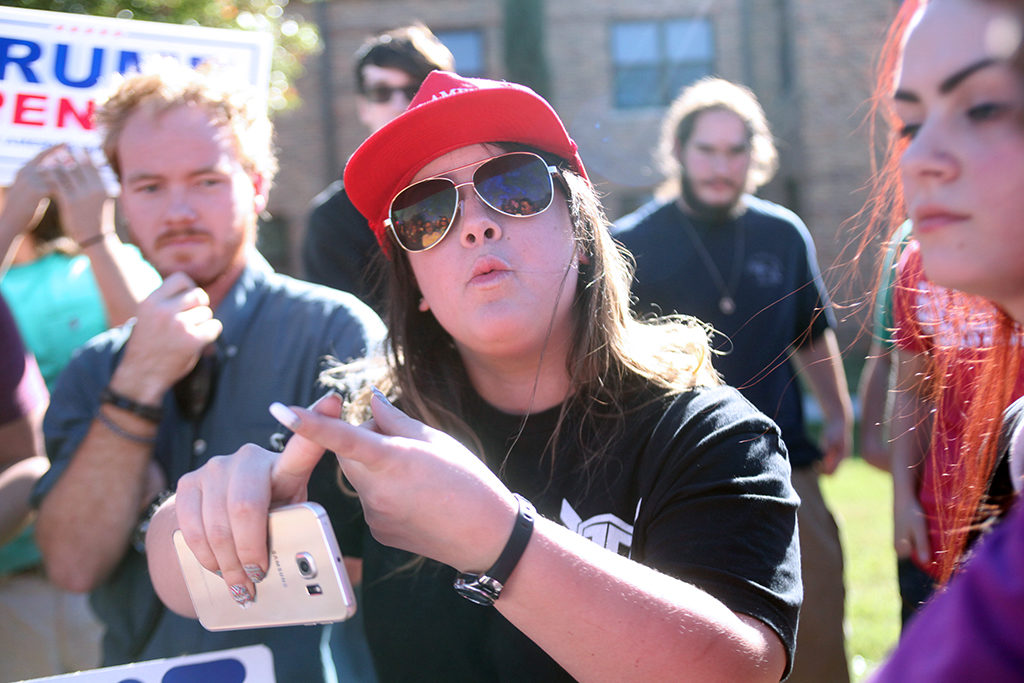 Gabriella Victoria, criminal justice, discusses, with the crowd of peaceful protesters, the advantages of having Donald Trump as president at a Nov 16 rally on campus. Members of a student group, PRIDE, said they plan another rally Feb. 1 at 2 p.m. outside Clark Student Center. Photo by Bridget Reilly