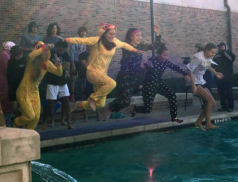 With the most people jumping, Rider High School students jump together for the Polar Plunge on Jan. 28. Photo by Cortney Wood