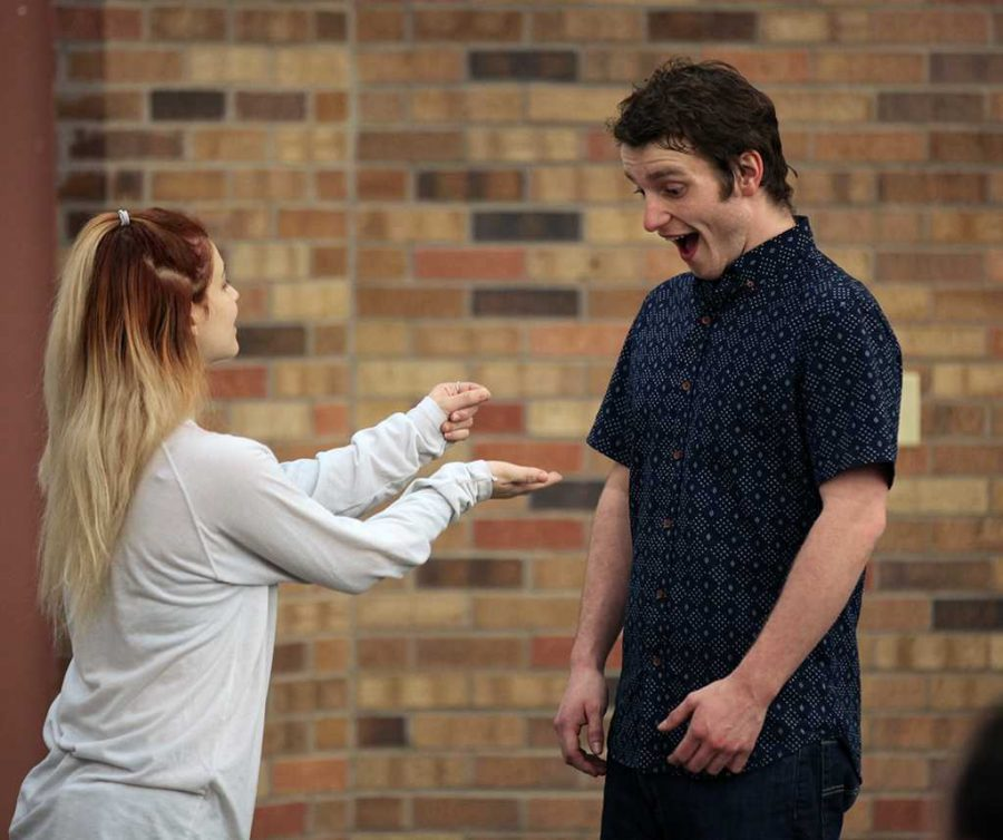 Tessa Dschaak, theater sophomore, and Jonathon Stone, theater junior, perform and teach student athletes about sexual assault on Jan. 25. Photo by Bridget Reilly