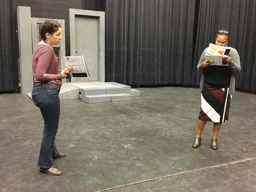 Ellanor Collins, theater junior and director, discusses the shift in tone for the Ladies in Red monologue with Cammie Dean, director of student development and orientation on Feb. 7. Photo by Cortney Wood