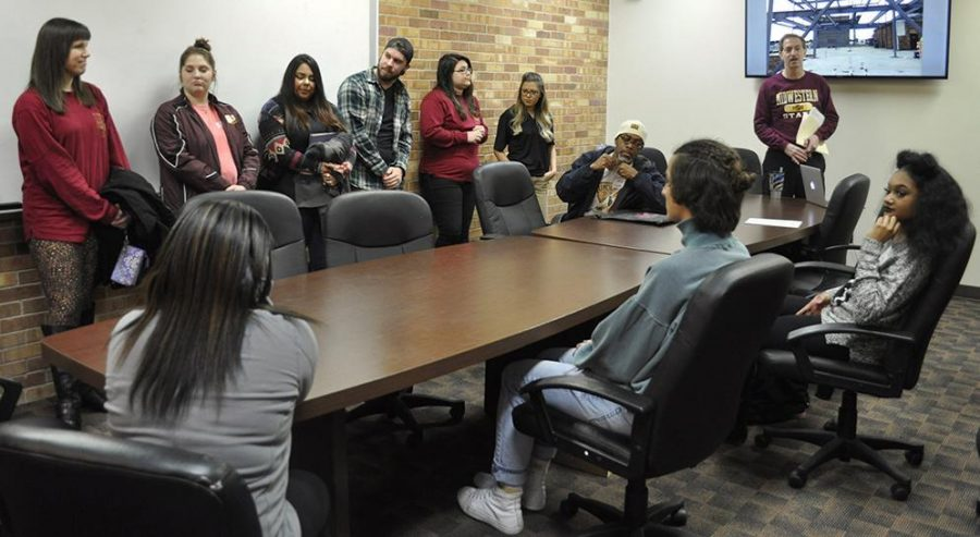 Jim Sernoe, mass communication chair, talks with prospective students in the Fain Fine Arts conference room during Discover MSU on Feb 3. Photo by Arianna Davis