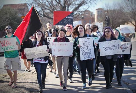 Students and faculty march through the streets of campus protesting the immigration executive order Feb. 1. Photo by Bridget Reilly