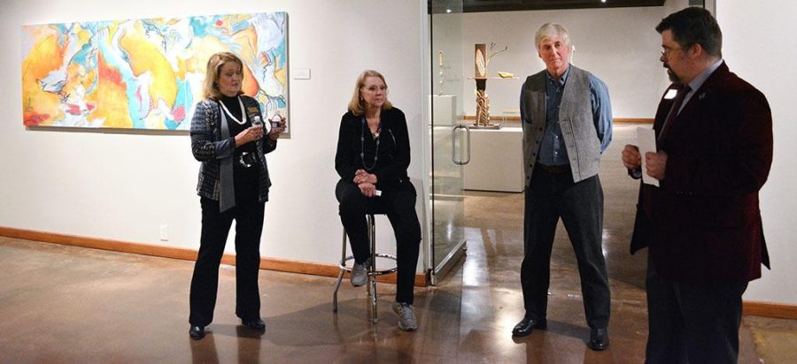 Sherry Giryotas, painter, and Phillip Shore, sculpturist, speaking at their exhibition on Feb. 3. Photo by Timothy Jones