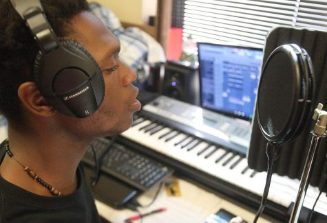 Able-Olu Jordan, computer science sophomore, practices with his professional recording equipment. Photo by Rachel Johnson