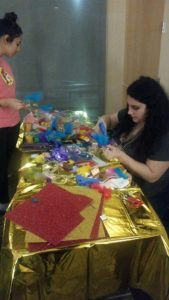 students decorate their masks at UPB Mardi Gras event