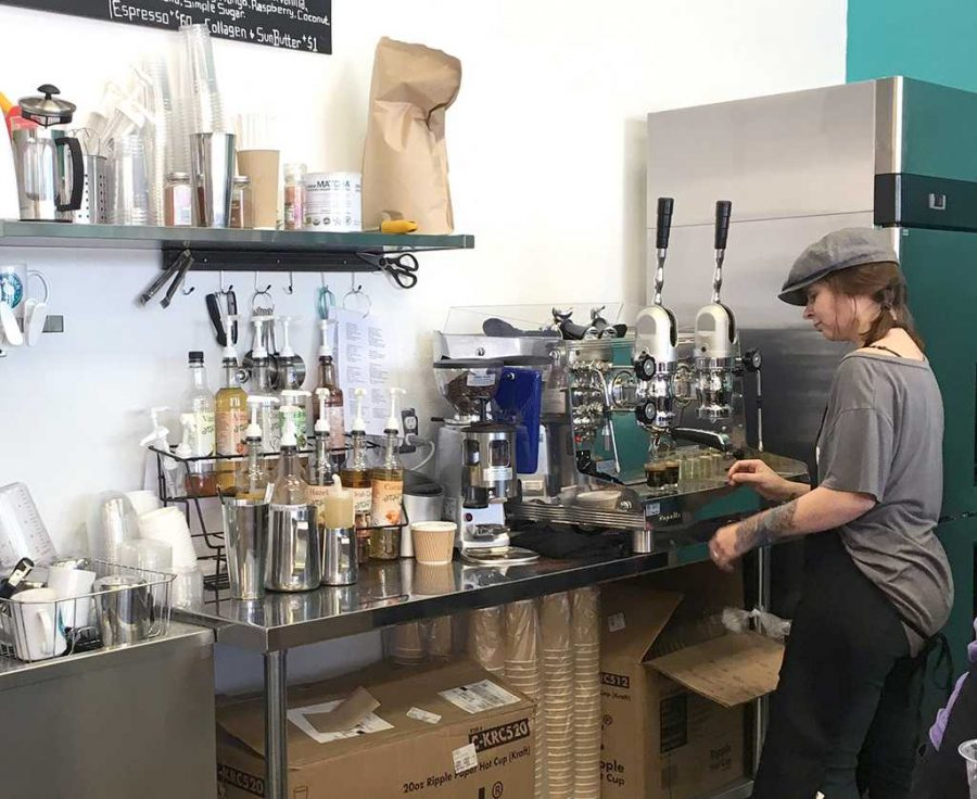 Christa Cooper, head barista, pulling shots at Odd Duck Coffee on March 21. Photo by Robin Reid.