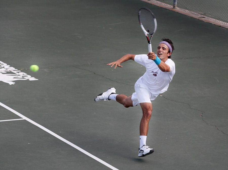 Ramon Toyos, mathematics and psychology senior, returns the ball to the other side during a doubles game against Metro State at the MSU Tennis Center. Photo by Rachel Johnson