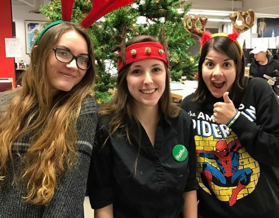 Tiffany Thoes, art sophomore, Aaron Campbell, painting senior, and Selena Mize, painting senior, all pose for a photo at the Christmas Art Sale. Image courtesy Elizabeth Yarosz-Ash.