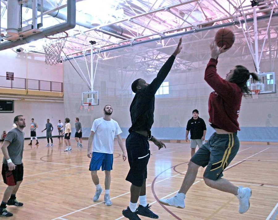 Matt Reed, criminal justice senior, shoots a fadeaway jump shot while defended by Khyce Randall, kinesiology junior at the Swishes for Wishes basketball tournament. Photo by Timothy Jones