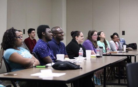A crowd of approximately 25 show up to watch students give their presentations during the 11th Annual Redwine Honors Program Symposium on March 25. Photo by Arianna Davis