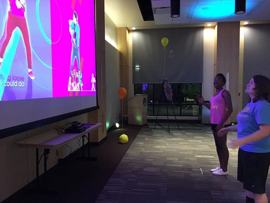 University Programming Board members Kenadi Campbell and Nikatha Conlay compete in Just Dance battle at Just Dance Dance Off March 30.