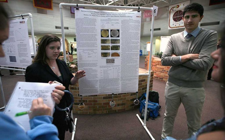 Meaghan Rose, biology senior, and Salvator Capotosto, biology senior, present their research on bacterial endophytic diversity during EUREKA on April 27. Photo by Arianna Davis