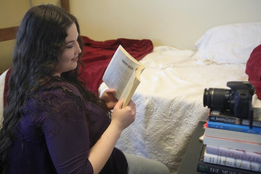 Whitney Atkinson, English junior, holds her favorite book,