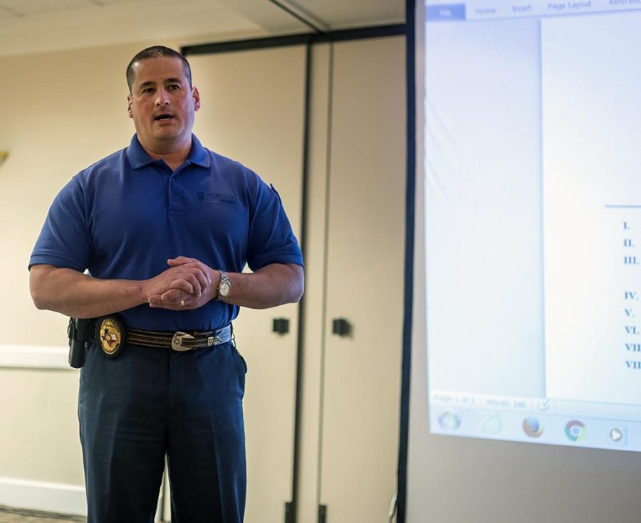 Police Chief Patrick Coggins discusses campus carry at the first SGA meeting Oct. 4. Photo by Izziel Latour