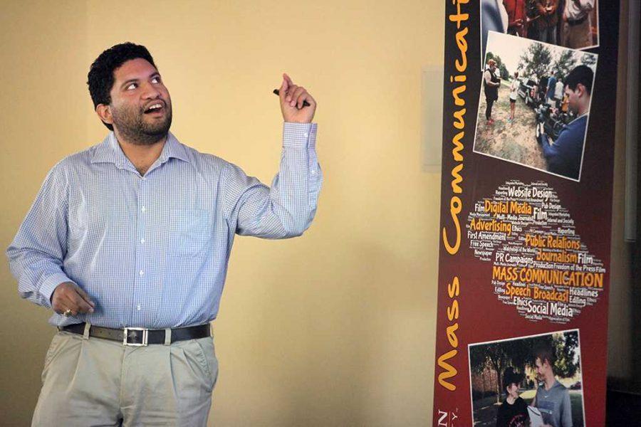 University social media coordinator A.J. Lopez gives a presentation on Snapchat on Social Media Day, Oct. 24. Photo by Dewey Cooper